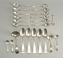 TWENTY-THREE PIECES OF AMERICAN AND STERLING SILVER Five tablespoons, twelve teaspoons, three ladles and three miscellaneous spoons....