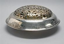 STERLING SILVER CENTERPIECE BOWL BY INTERNATIONAL SILVER CO. With rolled rim and repoussé floral decoration. Inscribed
