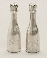 DOMINICK & HAFF STERLING SILVER SALT AND PEPPER SET In the form of champagne bottles. Engraved
