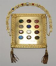 ROYAL ARCH MASON BREAST PLATE Brass-colored sheet metal mounted with twelve multicolored stones and engraved with the names of the t...