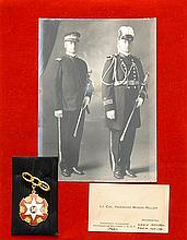 MATTED SET OF I.O.O.F. MEMORABILIA A black and white photo of two members, a 14kt gold 50-year medal and a business card for Lt. Col...