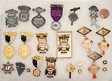 TWENTY-FOUR FRATERNAL MEDALS Sizes and materials vary.