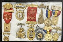 TWELVE FRAMED FRATERNAL MEDALS Sizes and materials vary. One is 14kt gold. Mounted together in a shadow box frame, 8.25