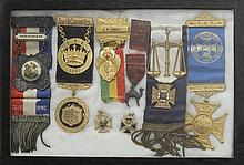 EIGHT FRAMED FRATERNAL MEDALS Sizes and materials vary. Mounted together in a shadow box frame, 8.25