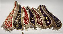SEVEN I.O.O.F. COLLARS In red or purple velvet with gold or silver trim and fringe. All embroidered with various symbols, names, etc...
