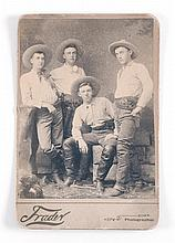 RARE CABINET CARD DEPICTING FOUR COWBOYS By F.A. Trader of Emporia, Kansas. 6.5