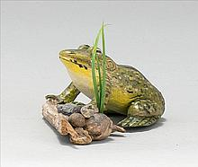CONTEMPORARY LIFE-SIZE CARVING OF A BULLFROG Partially standing on a driftwood, rockery and grass base. Signed on left foot