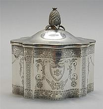 STERLING SILVER TEA CADDY Made for Tiffany & Co. In Adams form with pineapple finial and engraved body. Monogrammed. Height 5