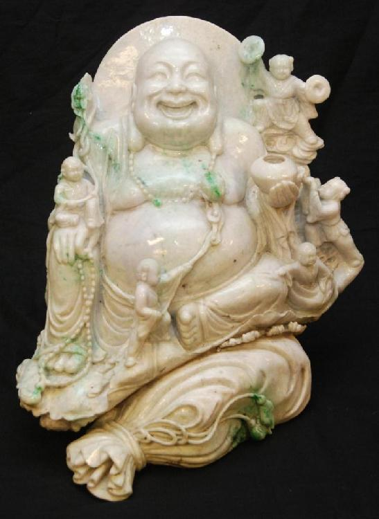 A LARGE CHINESE CARVED JADEITE BUDDHA BOULDER