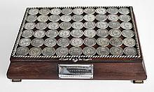 COFFRE A CIGARES en palissandre et argent, le couvercle composé de 54 pièces d'a
