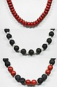 Set of 3 stone necklaces: 1 necklace of sponge coral, 1 necklace of lava beads with sponge coral beads, and one necklace of lava beads with