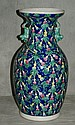 19th C Chinese porcelain vase with figural handles.