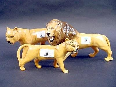 A Beswick pottery figure of a lion, model 2089, facing left, 5.5in high; another figure of a lioness, model 1507, facing left, golden frown gloss,