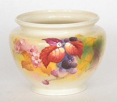 A Royal Worcester jardiniere, shape F132 decorated