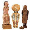 Three Egyptian wooden figures, probably second intermediate period to third intermediate period, 1650-664 b.c., Depicting seated boatma