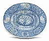 Continental blue and white faience charger, 19th century, The dished oval form with raised central reserve depicting two female nudes a