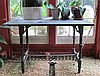 Cast iron and slate potting table, late 19th/early 20th century, The rectangular slate top supported on baluster-cast legs joined by H-