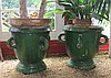Pair of green glazed terracotta garden urns, probaly northern european, Campagna form with four loop handles, interior unglazed.