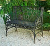 Victorian gothic wrought iron garden bench, mid 19th century, The rectangular back cast with trefoil and quatrefoil design, the sloped