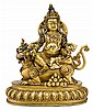 Sino-tibetan gilt bronze Vaishravana, 19th century, Seated in lalitasana on the back of his lion mount, carrying a mongoose, traces of