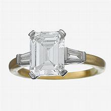 A diamond, eighteen karat gold and platinum ring, Tiffany & Co.,