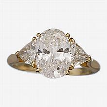A diamond, platinum and eighteen karat gold ring,