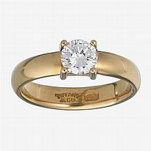 A diamond and twenty-two karat gold ring, Tiffany & Co.,