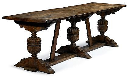 Fine English oak hall table, late 16th/early 17th century, The twin planked top over cup-and-cover carved supports terminating on sledg