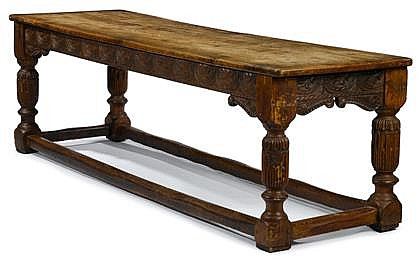 Large English oak refectory table, 17th century or later, The single plank rectangular top over leaf, scroll, and lunette carved frieze