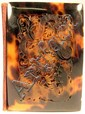 Carved tortoiseshell card case, , The rectangular case carved to show a reticulated dragon to one side, opening to a silk lined interio