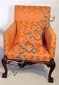 George II upholstered mahogany armchair, circa 1750 with restorations, The square back and sides over sprung seat, raised on acanthus a