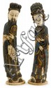 Pair of Chinese polychrome painted ivory figures, qing dynasty, Single section tusk carvings depicting male and female figures, the mal