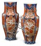 Large pair of Japanese Imari floor vases, early 20th century, Tapering cylindrical form with elongated neck, decorated all over in the