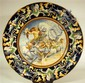 Large Italian majolica charger, 19th century, Centrally painted to show Zeus holding lightening bolts, Hera, and windheads, surrounded