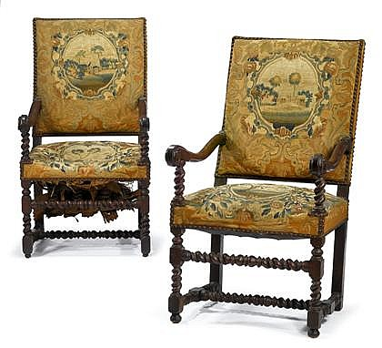 Pair of Louis XIV walnut fauteuils, circa 1700, The tapestry upholstered back and seat flanked by downswept arms, over spiral-carved st
