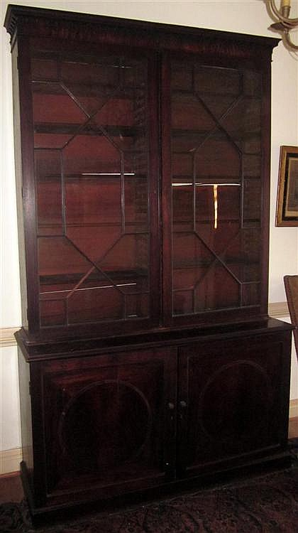 Good George III mahogany bookcase, late 18th century, In two sections: the upper section with molded cornice above Gothic arch frieze,