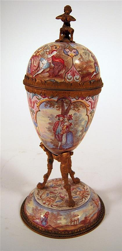Viennese enamel and gilt metal vase, late 19th century, The domed cover with satyr finial, the body worked to show 18th century couples
