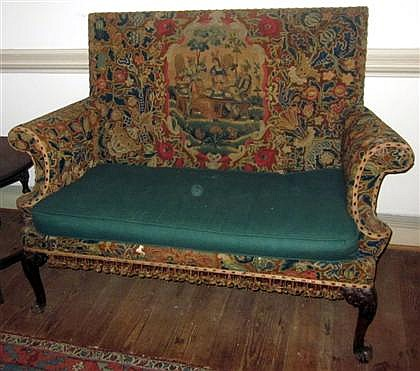 Fine George II mahogany settee, mid 18th century, The tapestry upholstered back and seat, raised on scroll and leaf carved cabriole leg