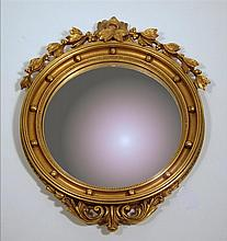 Regency style carved giltwood and gesso convex mirror, ,