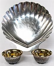 Japanese silver scallop-form dish, , Together with two salts with textured bodies and gilt-washed interior, in fitted original case. (3