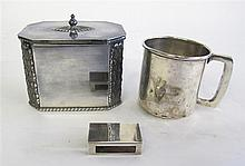 Sterling silver mug and matchbox, , together with silverplated lidded tea caddy. (3).