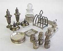 Collection of American sterling silver tablewares, , Including five pairs of salt and pepper shakers; thirteen nut dishes; a glass jug