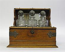Victorian brass bound oak and cut glass three piece tantalus set, circa 1890,