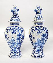 Pair of Delft blue and white covered vases, 19th century,