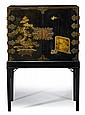 George III style gilt decorated black lacquer cabinet on stand, 19th century, The rectangular cabinet with two gilt metal mounted cupbo