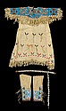 Child's Sioux beaded hide dress, leggings and concho belt, first third 20th century, The fringed yoke beaded in lane stitch with polyc