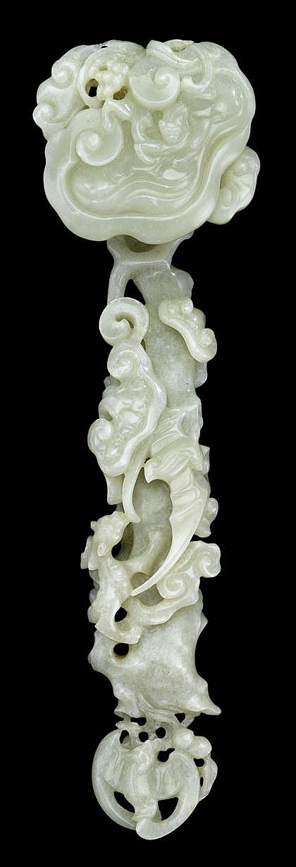 Chinese light celadon jade carved ruyi scepter, 19th century, Typical sinuous fungus form, the detail carved head showing qilong and sm