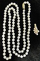 Lady's strand of pearls, , Opera length, pearls approximately 6mm, yellow gold, pearl and diamond slide.