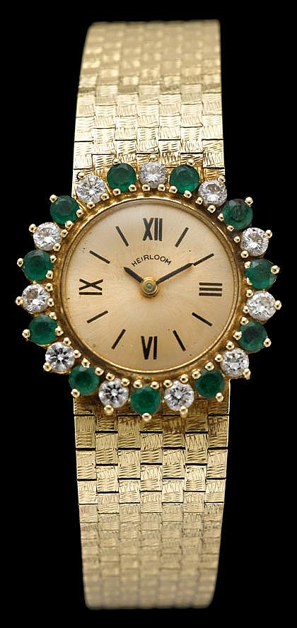 Lady's 14 karat yellow gold diamond and emerald wristwatch, Heirloom, , Circular case, brushed yellow gold face with Roman numeral dia