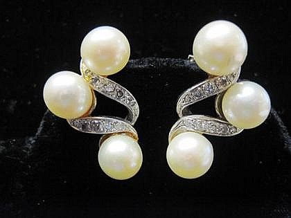 Pair of 14 karat white gold, pearl and diamond earrings, 20th century, Each set with three approximate 8.5 mm cultured pearls and ten g